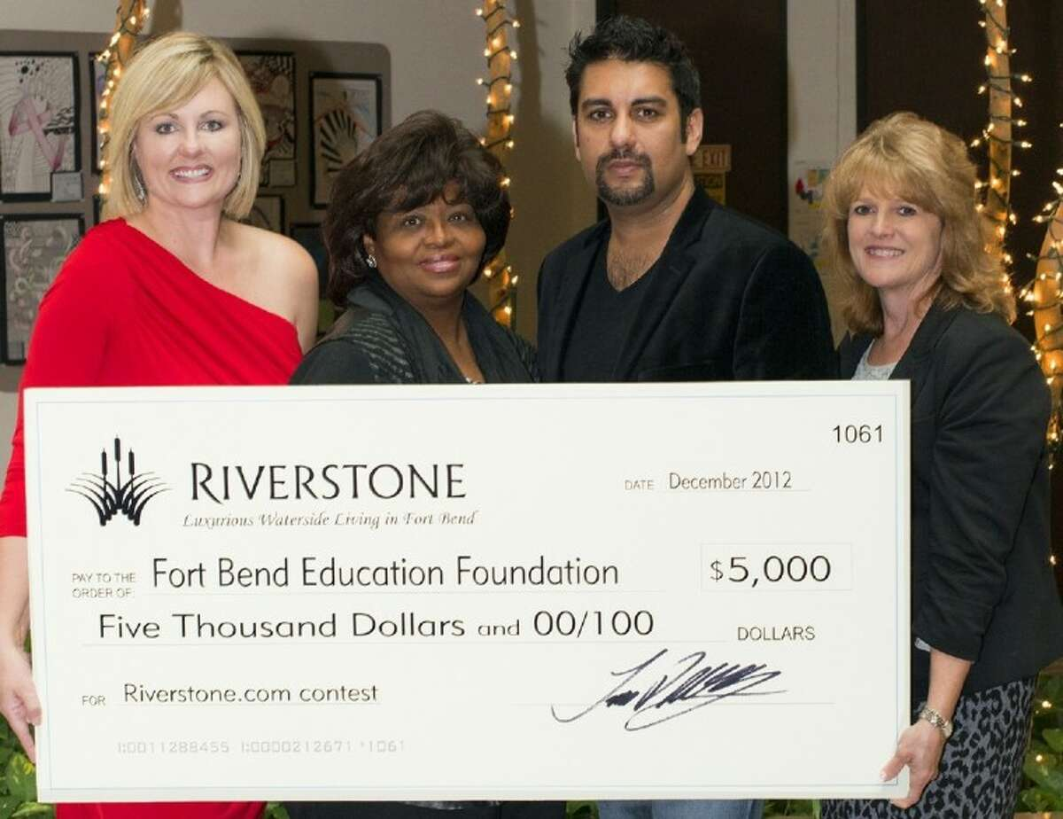 Riverstone has donated 5,000 to the Fort Bend Education Foundation after Rehan Siddiqi was named the community's Favorite Resident. Siddiqi selected the foundation as his charity of choice to receive the contest's prize. Shown here, left to right, are Christen Johnson, marketing director of Riverstone; Pat Houck, president, board of directors, Fort Bend Education Foundation, Riverstone's Favorite Resident Siddiqi, present and CEO of Hum Tum South Asian Radio; and Brenna Smelley, executive director of the Fort Bend Education Foundation.