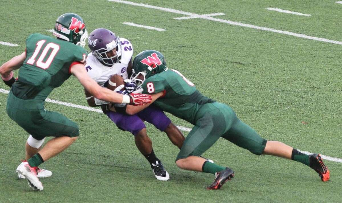 Corey Sanders (10) and Kade Markle will anchor the defense of The Woodlands against Cy-Fair on Friday night.