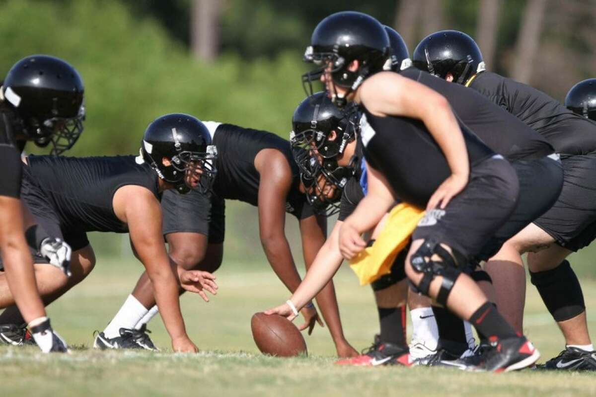Porter players practice a defensive play during practice Aug. 15.