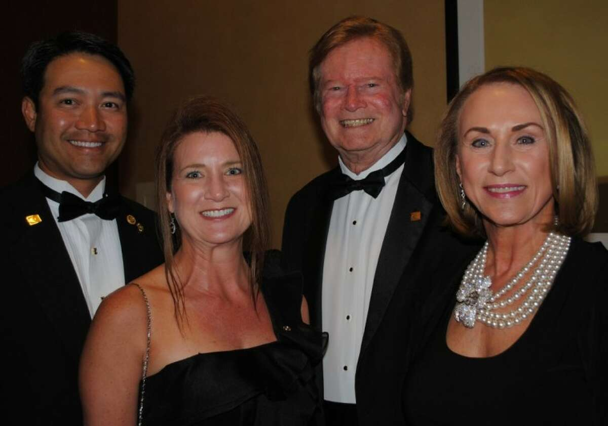 Jordis and Bob Wren of Friendswood, right, visit with Adrienne and Dr. Vissett Sun of Clear Lake at Friday night's Rotary Space Banquet in Houston. Both men are former presidents of the sponsoring Space Center Rotary Club.