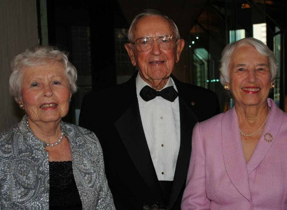 Retired Johnson Space Center Director Chris Craft arrives at the Rotary Space Gala with two lovely ladies, his wife, Bette, at left, and Ruth Cohen, wife of the late Aaron Cohen, also a JSC director.