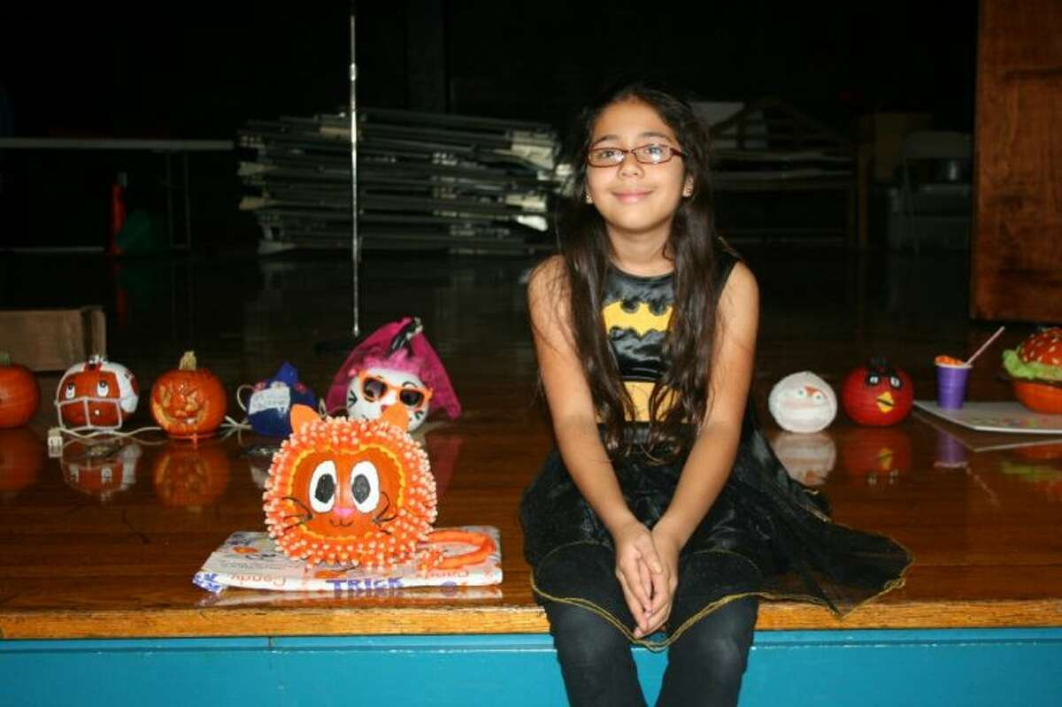 Peach Creek Elementary fourth-grade student Jules Cervantes won the annual pumpkin decorating contest for the second year in a row. Her entry this year was a candy corn embellished cat.