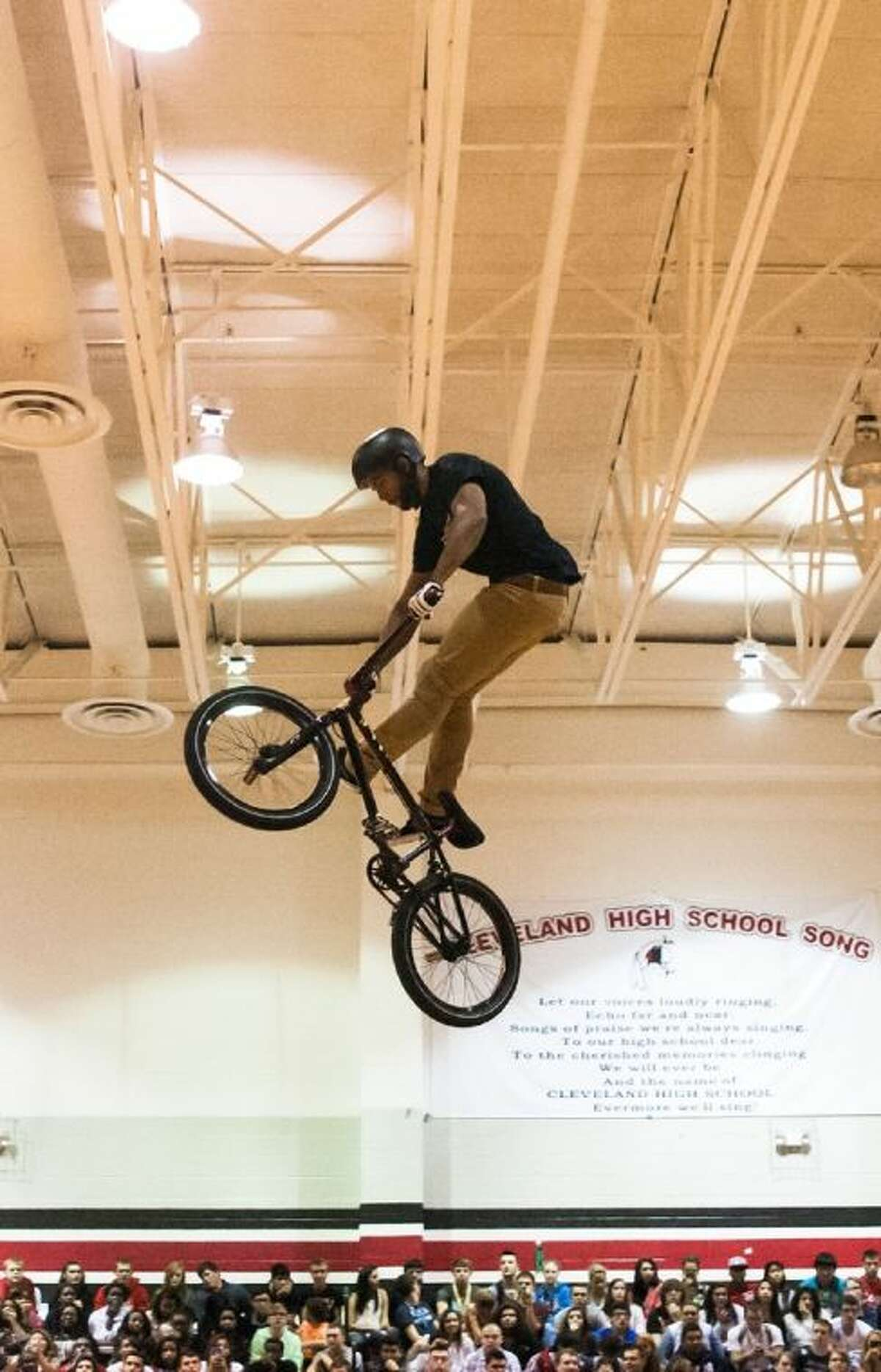 BMX Rider Mykel Larrin shows off an array of tricks at the ASA High School Tour stop in Cleveland on Oct. 30, 2013.