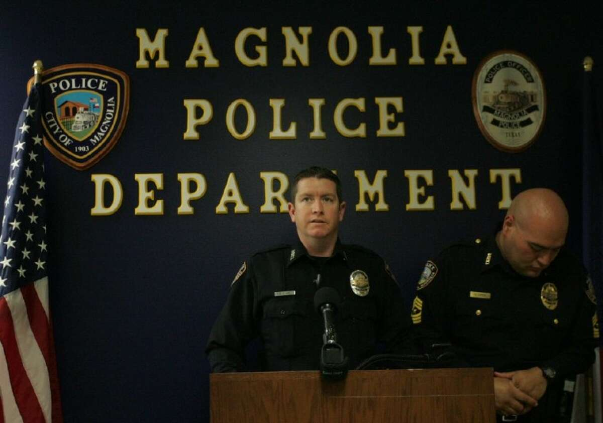 Magnolia Police Department Det. Brian Clack, left, and Sgt. Jose Lopez speak during a press conference Saturday.