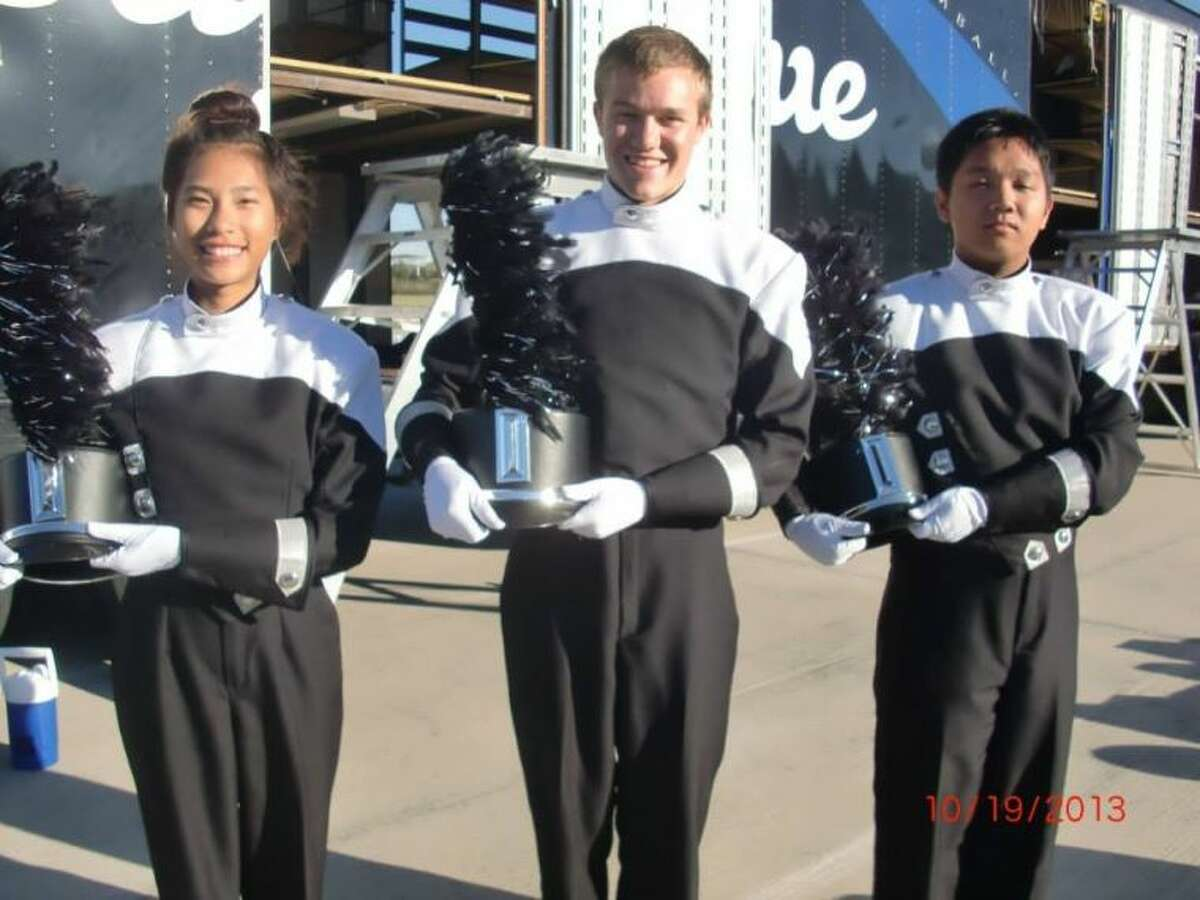The Roarin' Blue Band drum majors, from left to right, Brittany Nguyen, Spencer Holyoak and Danny Doan.