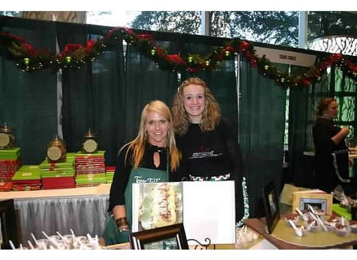 Kathy Croom and Mallory Yartym at the cookbook booth during the Junior League Harris County South Montgomery County Holiday Market. This year's Holiday Market is set for Nov. 15-17 at The Woodlands Waterway Marriott.