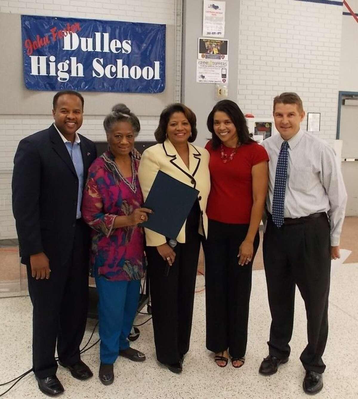 L-R: State Representative Ron Reynolds, Honoree Almeta Scott Crawford, Rhonda Crawford-Arnold, honoree's daughter; Lisa McMillian, honoree's sister; and Ronnie Edwards, principal of Dulles High School.