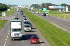 Early next year, Interstate 10 travelers will see delays between Beaumont and Winnie when the Texas Department of Transportation will begin construction to widen the road with a third lane. Cars travel on the highway near Smith Road on Thursday. Photo taken Thursday, September 29, 2016 Guiseppe Barranco/The Enterprise