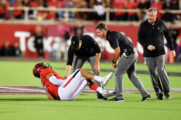 LUBBOCK, TX - SEPTEMBER 29: Patrick Mahomes II #5 of the Texas Tech Red Raiders is injured during the third quarter of the game against the Kansas Jayhawks on September 29, 2016 at AT&T Jones Stadium in Lubbock, Texas. Texas Tech won the game 55-19.