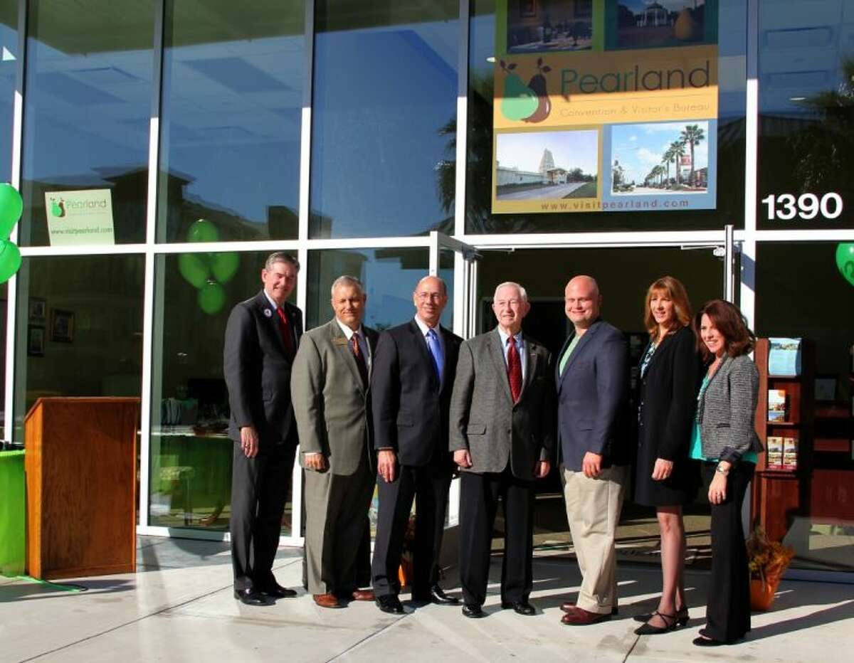 A Ribbon Cutting Ceremony was held recently to celebrate the grand opening of the new Pearland Town Center location of the Pearland Convention and Visitors Bureau (CVB). Pictured from left: State Rep. Ed Thompson, Pearland Assistant City Manager Mike Hodge, City Manager Bill Eisen, Mayor Tom Reid, Pearland City Councilmember Tony Carbone, Kim Sinistore, City of Pearland Convention & Visitors Bureau Executive Director and CVB Marketing Manager Tracy Rohrbacher