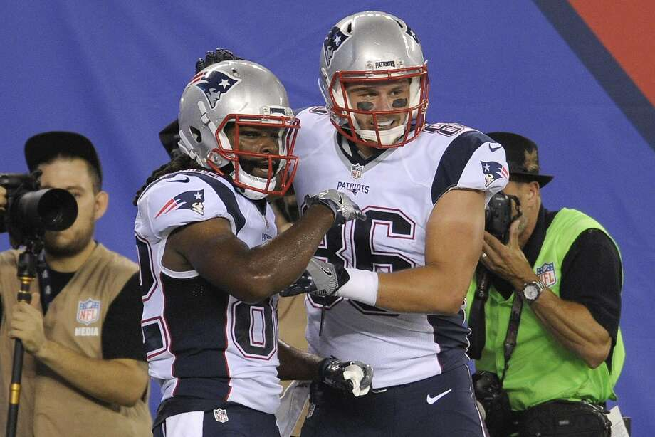 Keshawn Martin (left) celebrates his seven-yard TD catch in New England's preseason finale on Sept. 1. Photo: Bill Kostroun, Associated Press