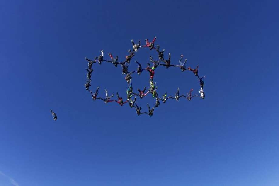 Thirty-four skydivers set a new state record for the largest head-down skydiving formation on Sunday, Nov. 3, at Skydive Spaceland just south of Houston.