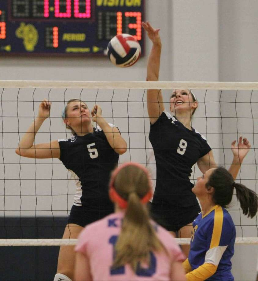 College Park's Emily Thorson (9) spikes the ball during a Region II-5A bi-district playoff match at Klein Collins High School Tuesday. College Park defeated Klein Collins in straight sets. Go to HCNPics.com to view this photos, and others like it.
