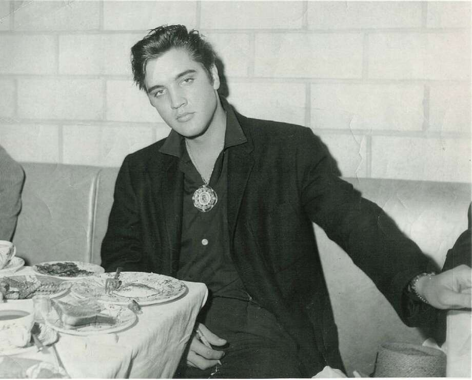 Elvis Presley sits at a booth inside the Little Shamrock Café during his only known visit to Cleveland during 1957. Photo: Cleveland Historical Society