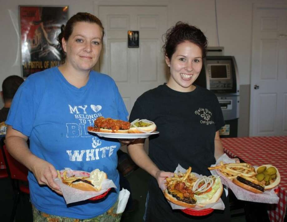 Randi and Sarah, lead waitresses at the Texas Grill, are happy to serve customers a hot plate of food with a friendly smile.