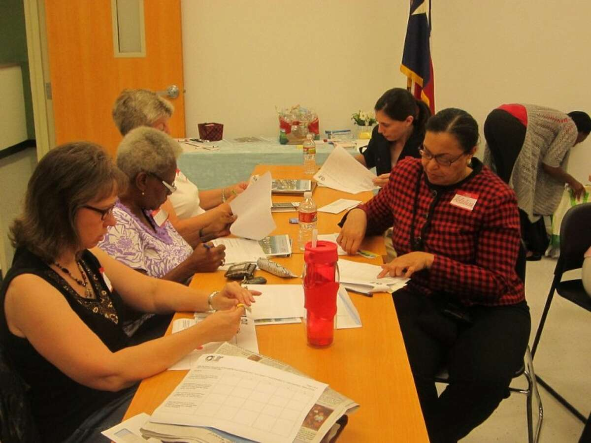 Local residents fill out a survey regarding ideas and goals for the Houston Galveston Regional Plan for Sustainable Development