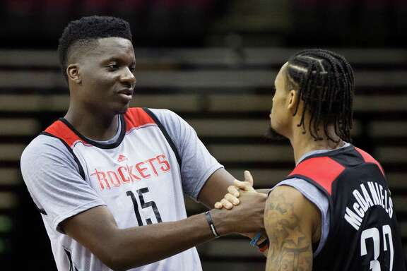 Houston Rockets center Clint Capela, left, and guard-forward KJ McDaniels, right, talk to each other after their team's first day of practice, Saturday, Sept. 24, 2016, in Houston. ( Marie D. De Jesus / Houston Chronicle )