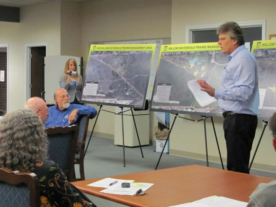 Ray Runge, standing at right, makes the case for neighbors of Willow Waterhole Compartment 3 to Glenn Laird, seated, with Harris County Flood Control District during a meeting Wednesday in southwest Houston. Photo: Robin Foster