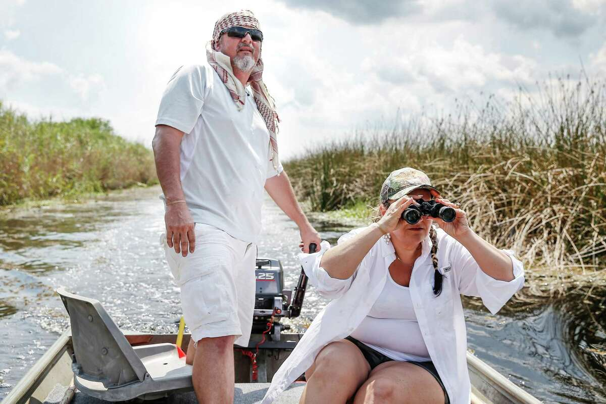 Nancy searches for gators. It's the first time she's hunted them.