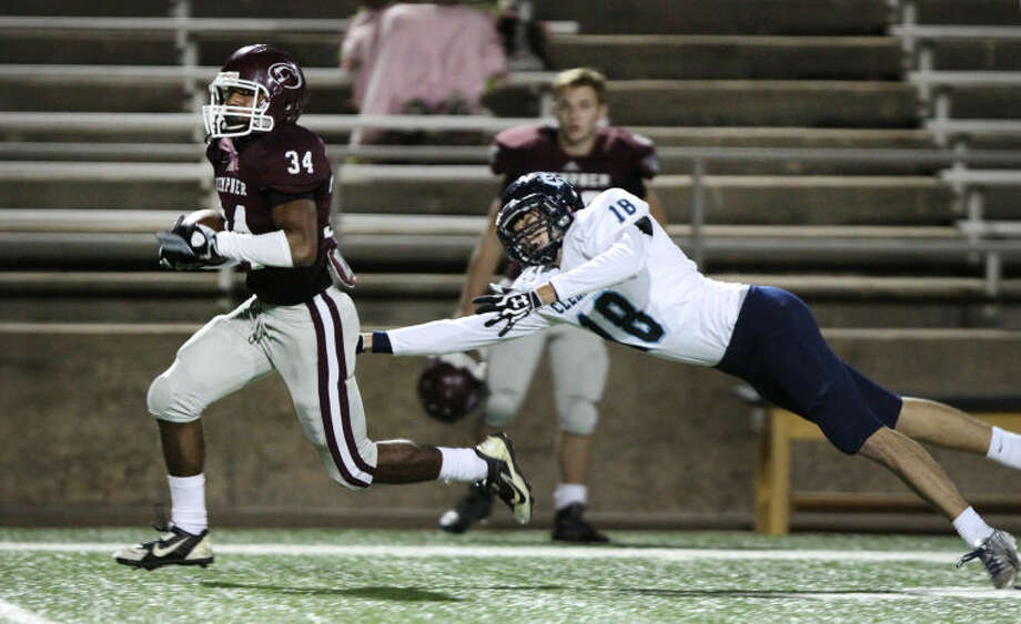 Kempner's Nicholas Anderson breaks free from Clements' Conrad Heinrich during a District 23-5A game Nov. 7 at Mercer Stadium in Sugar Land. Anderson scored five touchdowns as Kempner won 49-42.To view or purchase this photo and others like it, go to HCNPics.com.