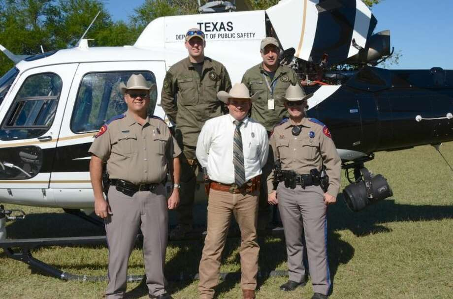 Texas Ranger Stephen Rayburn, center, stands with other law enforcement officers and members of the Texas Department of Public Safety helicopter crew at the Church of Jesus Christ of Latter-day Saints' recent regional weekend Camporee.