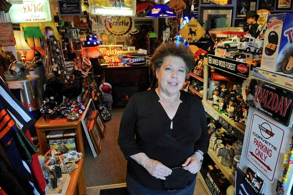 """Sher Hall has grown her collection of vinyl records in her thrift store, """"Up A Notch"""", on Tuesday, September 27, 2016, in Bethel, Conn."""