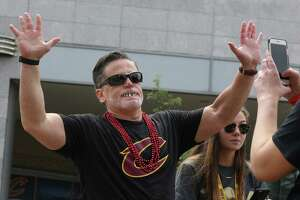 Cleveland Cavaliers owner Dan Gilbert clowns around with fans during the team's NBA Championship celebration on Wednesday, June 22, 2016, in Cleveland.