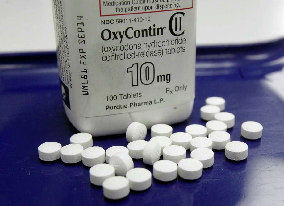 FILE - This Feb. 19, 2013, file photo, shows OxyContin pills arranged for a photo at a pharmacy in Montpelier, Vt. Facing what's been called an opioid drug epidemic, Utah police, prosecutors and politicians are set to speak about how to investigate and prosecute heroin and other drug cases at the Utah Heroin and Opioid Summit in Salt Lake City. (AP Photo/Toby Talbot, File) Photo: Toby Talbot / Associated Press / Copyright 2016 The Associated Press. All rights reserved.