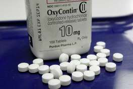 FILE - This Feb. 19, 2013, file photo, shows OxyContin pills arranged for a photo at a pharmacy in Montpelier, Vt. Facing what's been called an opioid drug epidemic, Utah police, prosecutors and politicians are set to speak about how to investigate and prosecute heroin and other drug cases at the Utah Heroin and Opioid Summit in Salt Lake City. (AP Photo/Toby Talbot, File)