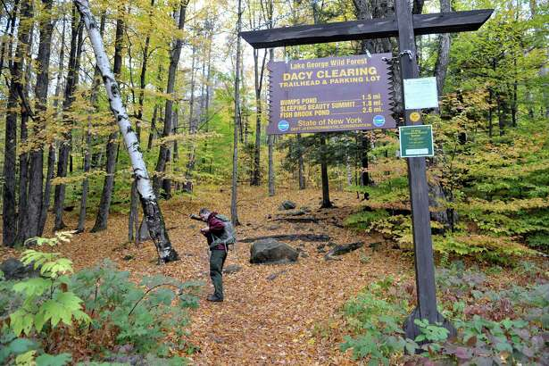 Scott van Laer heads out on the trail to Sleeping Beauty mountain on Tuesday, Oct. 20, 2015, in Fort Ann, N.Y.  Van Laer  was searching in the area for the wreckage site of a plane that crashed in the area over 30 years ago.   (Paul Buckowski / Times Union)