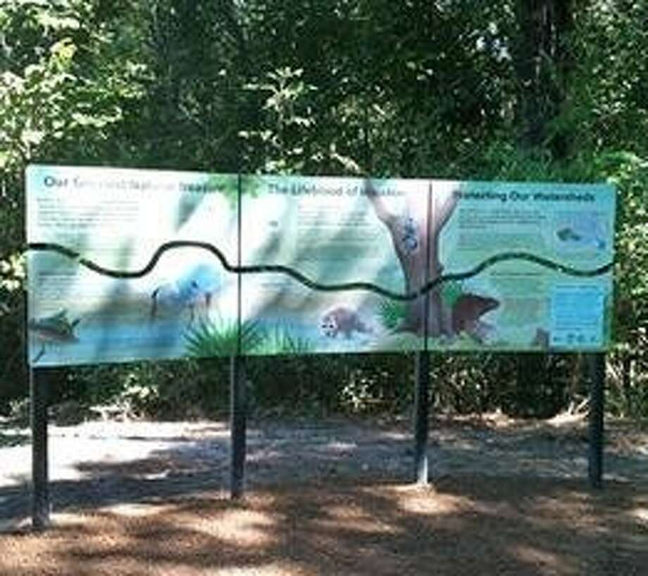 Interpretive signage points out features and wildlife along Buffalo Bayou in Terry Hershey Park.