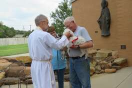 Father David Huxley performs the annual blessing of the animals at St. Nicholas' Episcopal Church.