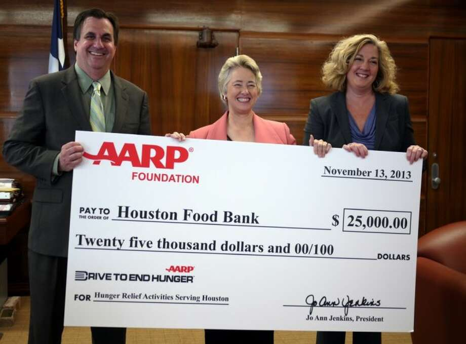 Houston Food Bank President and CEO Brian Green (left), Mayor Annise Parker, and Amanda Fredriksen, Texas AARP advocacy director.