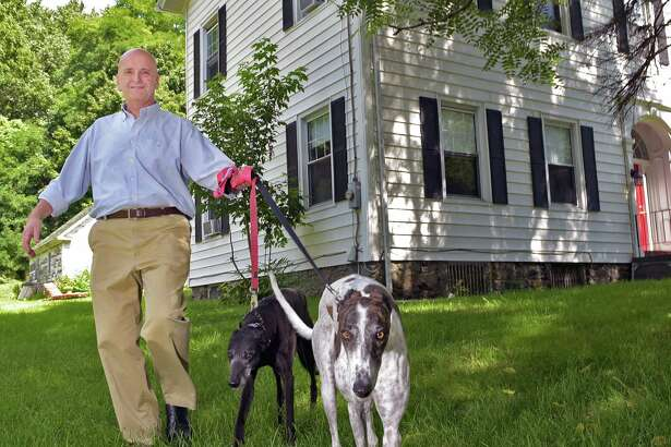 Owner John Hughes with his rescued Greyhounds, Josie and Nigel in front of his Gardner Farm Inn at 59 Brunswick Road Tuesday Aug. 30, 2016 in Troy, NY.  (John Carl D'Annibale / Times Union)