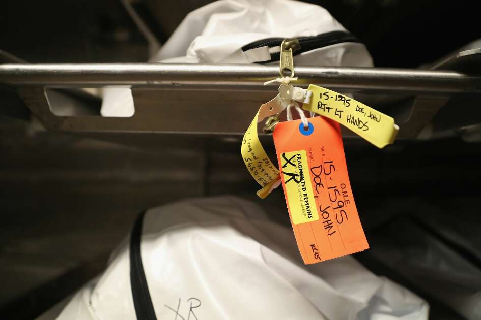 TUCSON, AZ - SEPTEMBER 29: (EDITORS NOTE: Image depicts death.) Bodies of suspected undocumented immigrants lie in the morgue the Office of the Pima County Medical Examiner on September 29, 2016 in Tucson, Arizona. Hundreds of migrants die every year, most from dehydration, in the desert while crossing illegally from Mexico into the United States. Forensic anthropologists study personal effects and bodily remains in an effort to identify the bodies and reunite them with loved ones. (Photo by John Moore/Getty Images)