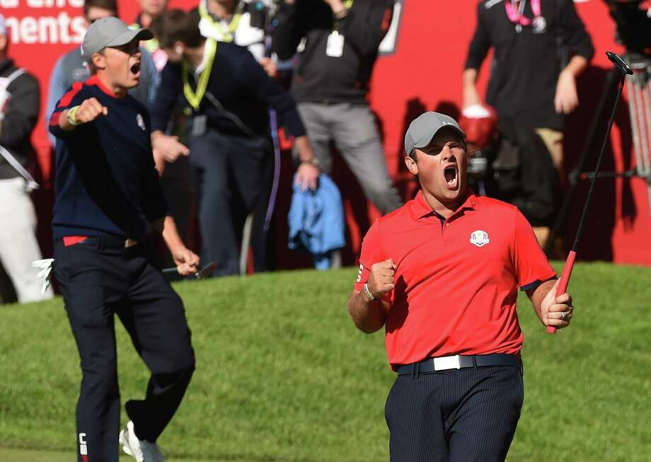 Team USA Patrick Reed (R) reacts with teammate Jordan Spieth after winning their match against Team Europe Justin Rose and Henrik Stenson on the 16th green during the Morning Foursome matches at the 41st Ryder Cup at Hazeltine National Golf Course in Chaska, Minnesota, September 30, 2016 / AFP PHOTO / TIMOTHY A. CLARYTIMOTHY A. CLARY/AFP/Getty Images Photo: TIMOTHY A. CLARY, AFP/Getty Images / AFP or licensors