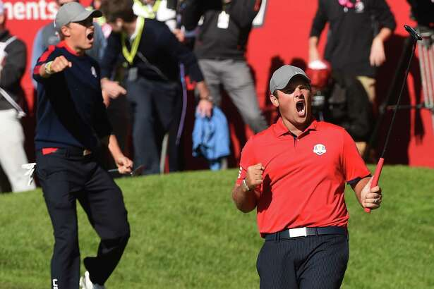 Team USA Patrick Reed (R) reacts with teammate Jordan Spieth after winning their match against Team Europe Justin Rose and Henrik Stenson on the 16th green during the Morning Foursome matches at the 41st Ryder Cup at Hazeltine National Golf Course in Chaska, Minnesota, September 30, 2016 / AFP PHOTO / TIMOTHY A. CLARYTIMOTHY A. CLARY/AFP/Getty Images