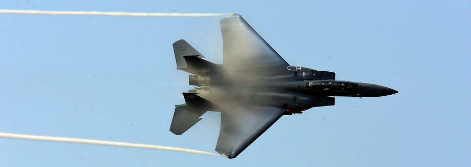 Vapor forms off the wings of an F-15E Strike Eagle during a performance at the Randolph Air Show Saturday, November 3, 2007 at Randolph Air Force Base. BAHRAM MARK SOBHANI/STAFF Photo: BAHRAM MARK SOBHANI, STAFF / SAN ANTONIO EXPRESS NEWS / SAN ANTONIO EXPRESS NEWS