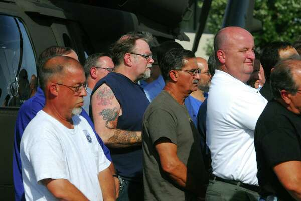Sikorsky workers listen during a news conference at Sikorsky Aircraft in Stratford on Sept. 21 as Gov. Dannel P. Malloy announces a deal with Lockheed Martin Corp. to keep Sikorsky in the state through 2032. The deal is contingent upon union approval.