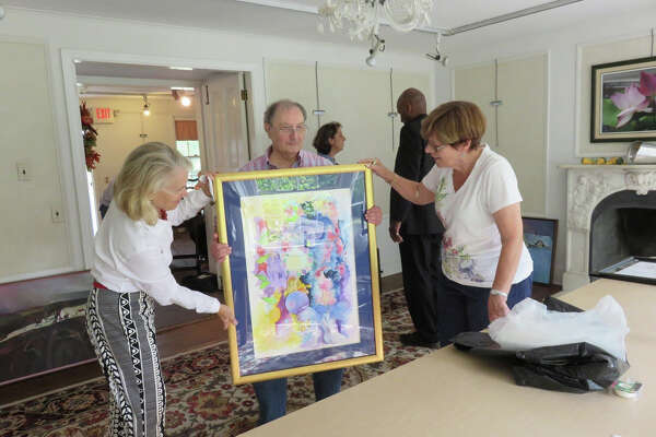 Richter Art Association's 38th Annual Juried Art Show opens Saturday, Oct. 1, from 2 p.m. to 5 p.m. at Richter House in Danbury. Seen here, from left, are board members Susan Roberts and Arline Corcoran as they examine Dominick Tomanelli's entry on receiving day for the 2015 show.