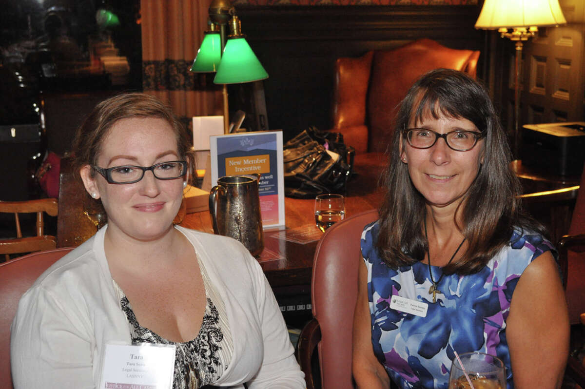 Legal Aid Staff Tara Sentz and Patricia Ranney at the welcome table.
