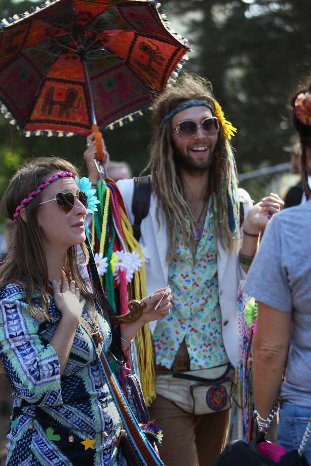 Promoting happiness, friendship and flower power, Kara Bohr and Chad Monette of San Francisco, sell their Gypsy Halo's at the Hardly Strictly Bluegrass Festival at Golden Gate Park. Oct. 3, 2015. The National Weather Service is forecasting a 20 percent chance of rain for San Francisco on Sunday, the last day of this year's music festival. Photo: Franchon Smith, The Chronicle