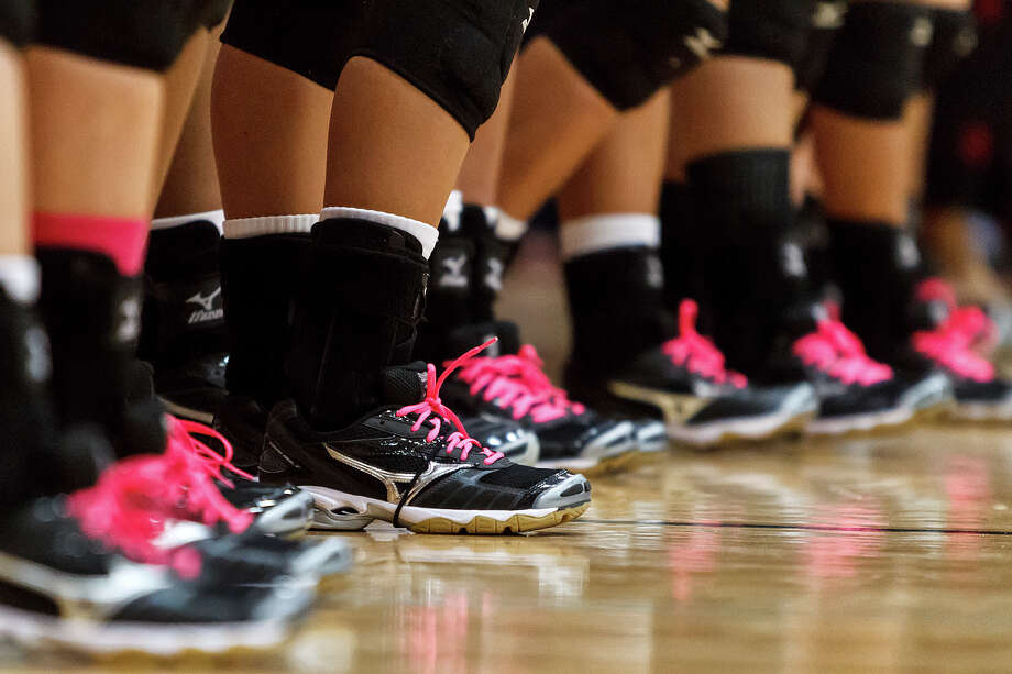 Many San Antonio area high school volleyball teams wear pink trim on their uniforms or, in this case, and pink shoelaces for matches during breast-cancer awareness month. Photo: Marvin Pfeiffer / San Antonio Express-News / Prime Time Newspapers 2012