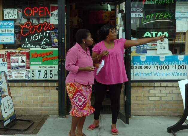 The 4th Congressional District streches from the city of Bridgeport, where there is much poverty, all the way down to Greenwich, one of the wealthiest cities in the state. Here, Osaretin Chavez, owner of Osadia Grocery Store points out a store where Mosa Osemobor can wire some money along Main Street in Bridgeport, Conn. on Tuesday May 04, 2010. Photo: Christian Abraham / Connecticut Post