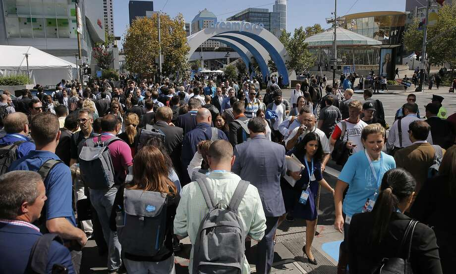 Attendees cross at the corner of Howard and Fourth streets at Salesforce's Dreamforce conference in 2015. More than 160,000 people have registered to attend the software company's conference this year, which opens on Tuesday. Photo: Michael Macor, The Chronicle