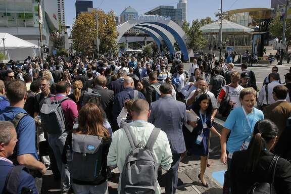 Attendees cross at the corner of Howard and fourth Streets, as Dreamforce gets underway at the Moscone Center in downtown San Francisco, Calif.,  on Tues. September 15, 2015.