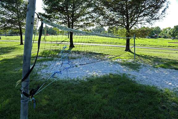 Grass growing in a sand volleyball court at Oak Meadow Park Sept. 29, 2016, in Houston. ( James Nielsen / Houston Chronicle )