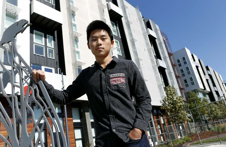 Kevin Hsiung is seen in front of his apartment building in San Francisco, Calif. on Friday, Sept. 30, 2016. When Hsiung moved into the new brand building earlier this summer, he was told he could only select internet service from two providers, AT&T or Comcast, though he preferred an independent service, Webpass. Photo: Paul Chinn, The Chronicle