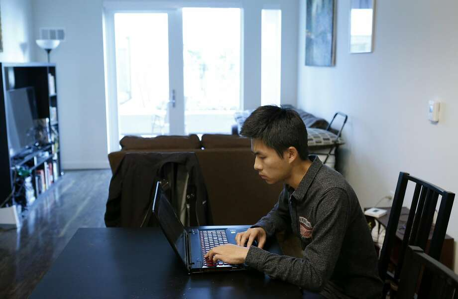 Kevin Hsiung works in his home in Potrero Hill. His building barred him from subscribing to his desired Internet provider. Photo: Paul Chinn, The Chronicle