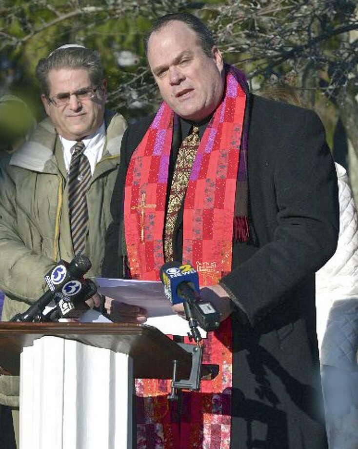 The Rev. Matt Crebbins, right, of Newtown Congregational Church Photo: / H John Voorhees III